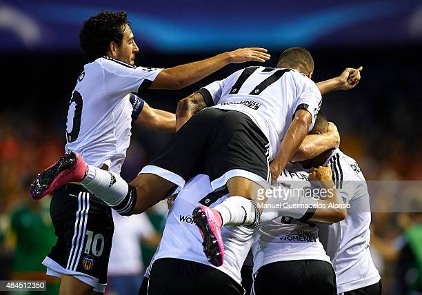 Valencia players celebrate the third goal with during the UEFA Champions League Qualifying Round Play Off First Leg match between Valencia CF and AS...