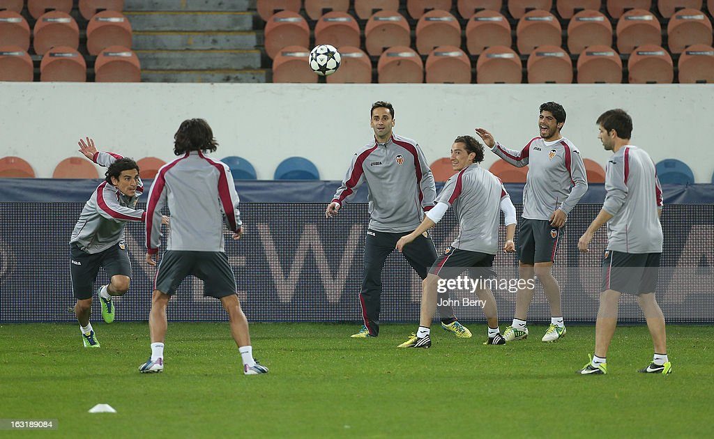 Valencia players warm up during the training session on the eve of the Champions League match between Paris Saint Germain FC and Valencia CF at the Parc des Princes stadium on March 5, 2013 in Paris, France.