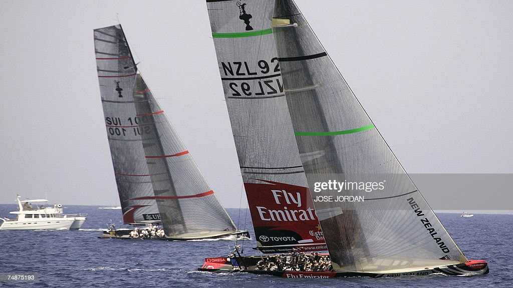 Emirates Team New Zealand lead Swiss Alinghi on the second day of racing in the 32nd America's Cup in Valencia 24 June 2007 Swiss defender Alinghi...