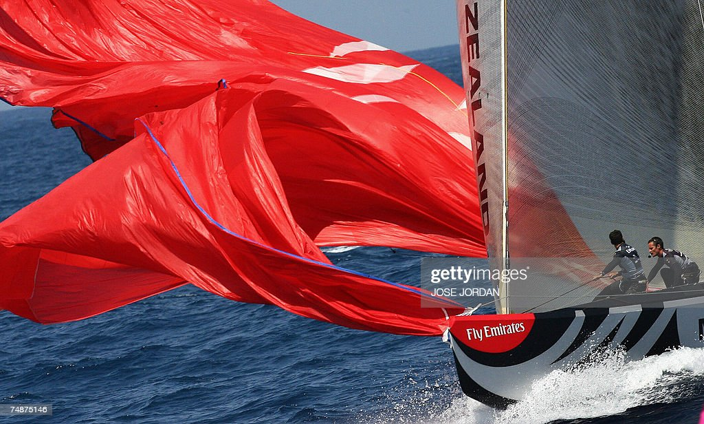 Emirates Team New Zealand pull in the spinnaker on the second day of racing in the 32nd America's Cup in Valencia 24 June 2007 Swiss defender Alinghi...