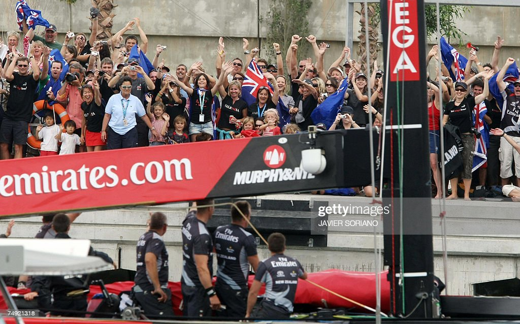 Kiwi fans wave at the Team New Zealand boat on the third day of racing in the 32nd America's Cup in Valencia 26 June 2007 Emirates Team New Zealand...