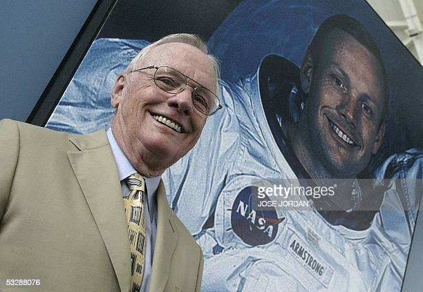 US austronaut Neil Armstrong poses in front of his photo during a visit to the Prince Felipe Museum in Valencia 26 July 2005AFP PHOTO JOSE JORDAN