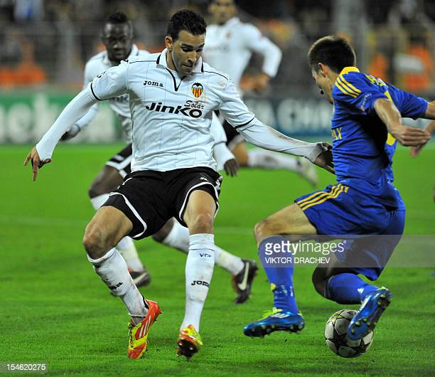 Valencia's Adil Rami vies with BATE Borisov's Marko Simic during their Champions League Group F football match in Minsk on October 23 2012 AFP PHOTO...