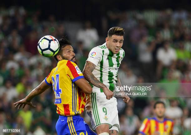 Valencia's Argentinian defender Ezequiel Garay vies with Real Betis' Paraguayan forward Arnaldo Sanabria during the Spanish league football match...
