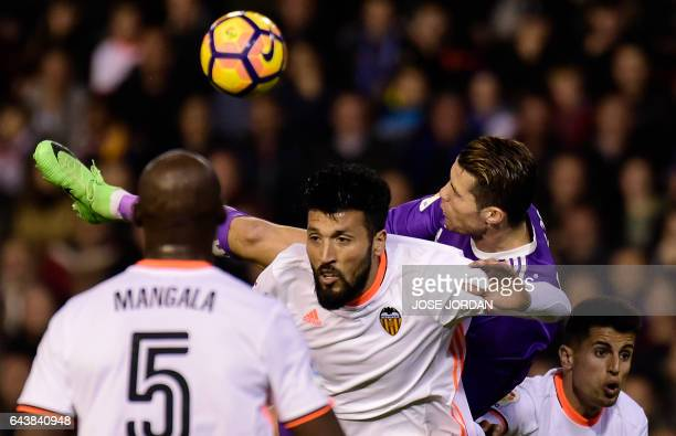 Valencia's Argentinian defender Ezequiel Garay vies with Real Madrid's Portuguese forward Cristiano Ronaldo during the Spanish league football match...