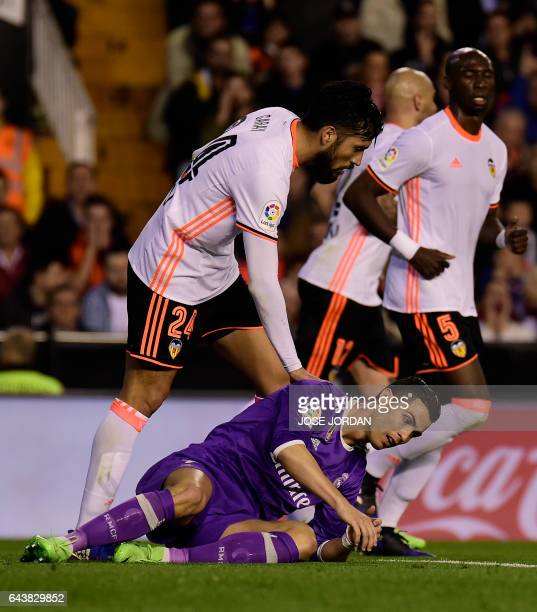 Valencia's Argentinian defender Ezequiel Garay vies with Valencia's French defender Eliaquim and Real Madrid's Portuguese forward Cristiano Ronaldo...