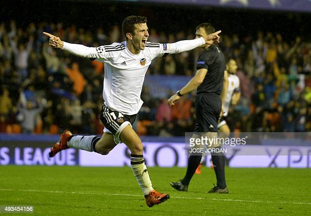 Valencia's Argentinian forward Pablo Piatti celebrates his goal during the UEFA Champions League group H football match Valencia CF vs KAA Gent at...
