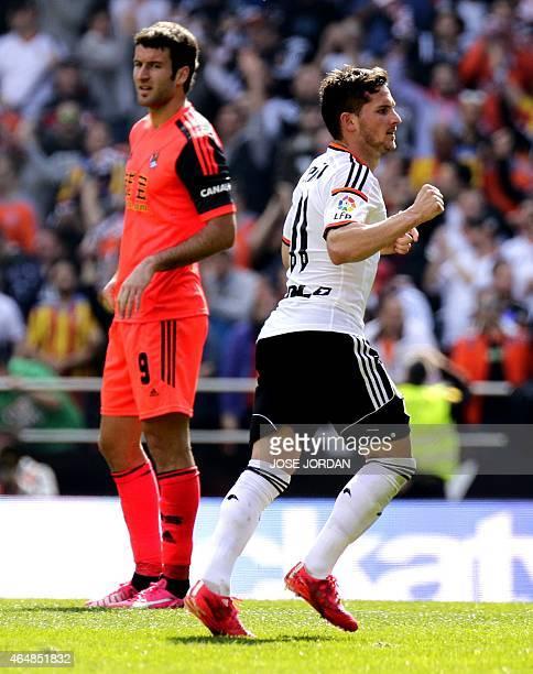 Valencia's Argentinian forward Pablo Piatti celebrates his goal next to Real Sociedad's forward Imanol Agirretxe during the Spanish league football...