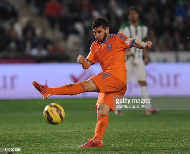 Valencia's Argentinian forward Pablo Piatti scores against Cordoba during the Spanish league football match Cordoba CF vs Valencia CF at The Nuevo...