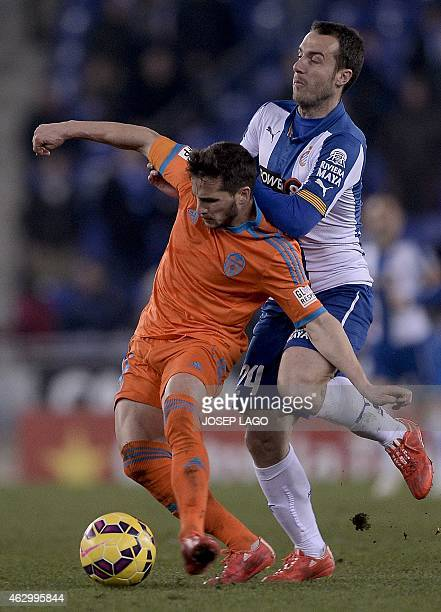 Valencia's Argentinian forward Pablo Piatti vies with Espanyol's midfielder Francisco Montanes Claverias during the Spanish league football match RCD...