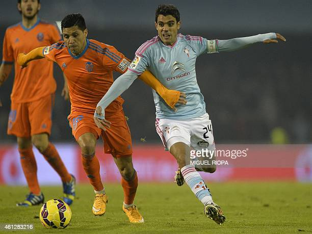 Valencia's Argentinian midfielder Enzo Perez vies with Celta's Argentinian midfielder Augusto Fernandez during the Spanish league football match RC...