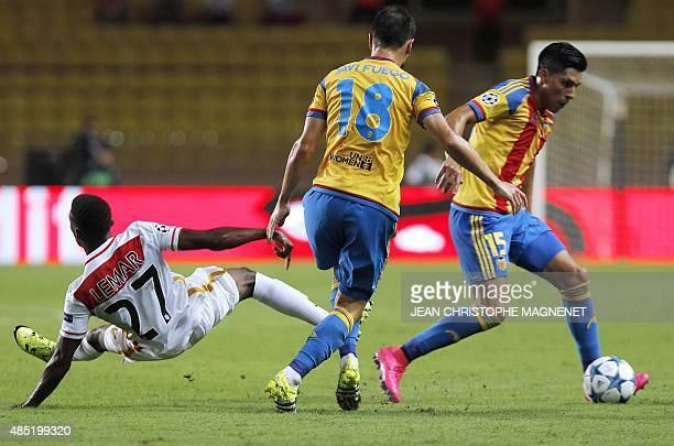 Valencia's Argentinian midfielder Enzo Perez vies with Monaco's French midfielder Thomas Lemar during the UEFA Champions League playoff football...