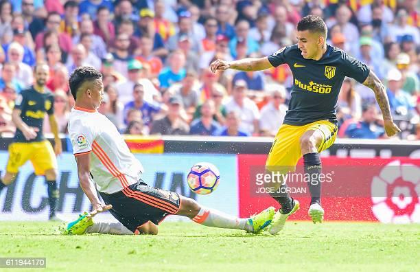 Valencia's Brazilian defender Aderlan Leandro de Jesus Santos vies with Atletico Madrid's Argentinian midfielder Angel Correa during the Spanish...
