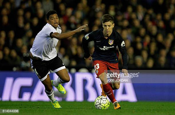 Valencia's Brazilian defender Aderlan Santos vies with Atletico Madrid's Argentinian forward Luciano Vietto during the Spanish league football match...