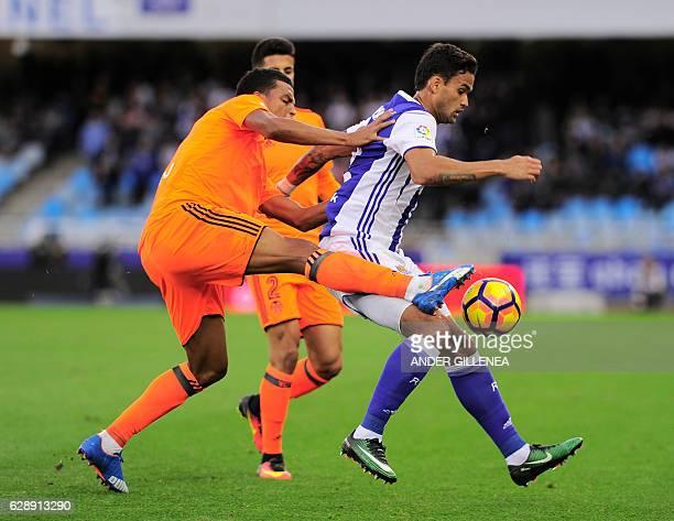 Valencia's Brazilian defender Aderlan Santos vies with Real Sociedad's Brazilian forward Willian Jose during the Spanish league football match Real...