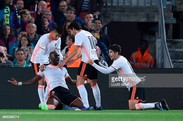 Valencia's Brazilian defender Eleaquim Mangala celebrates with teammates after scoring a goal during the Spanish league football match FC Barcelona...