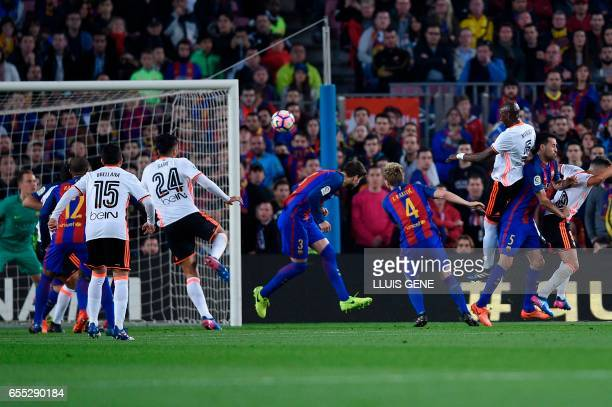Valencia's Brazilian defender Eleaquim Mangala scores a goal during the Spanish league football match FC Barcelona vs Valencia CF at the Camp Nou...