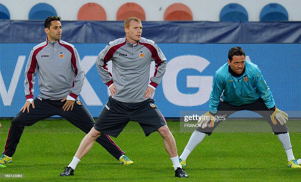 Valencia's Brazilian forward Jonas, Valencia's French defender Jeremy Mathieu and Valencia's Brazilian goalkeeper Diego Alves attend a training session at the Parc des Princes stadium in Paris, on the eve of their second leg of the UEFA Champions League last 16 match against Paris.