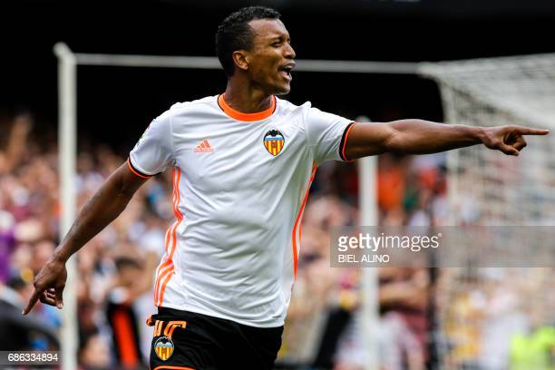 Valencia's Brazilian forward Rodrigo Moreno 'Nani' celebrates after scoring during the Spanish League football match Valencia CF vs Villarreal CF at...