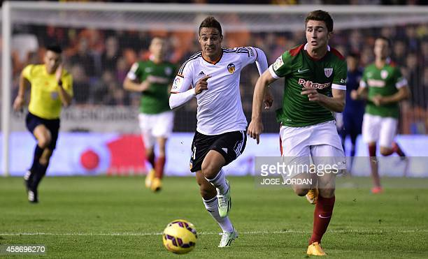 Valencia's Brazilian forward Rodrigo vies with Athletic Bilbao's French defender Aymeric Laporte during the Spanish league football match Valencia CF...