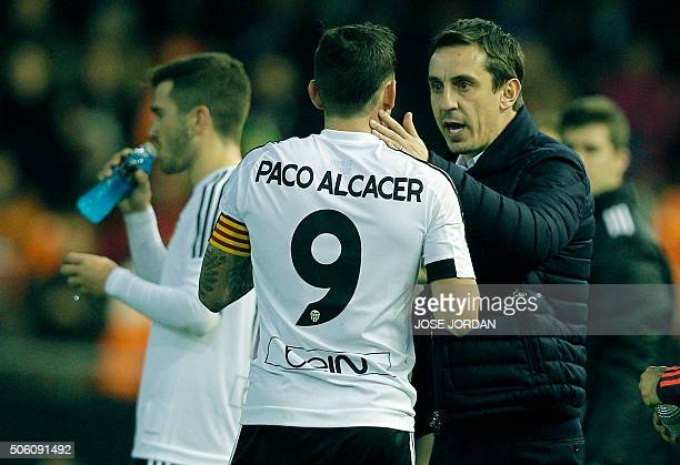 Valencia's British coach Gary Neville speaks with Valencia's forward Paco Alcacer during the Spanish Copa del Rey football match Valencia CF vs UD...