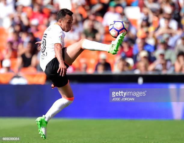 Valencia's Chilenian forward Fabian Orellana controls the ball during the Spanish league football match Valencia CF vs Sevilla FC at the Mestalla...