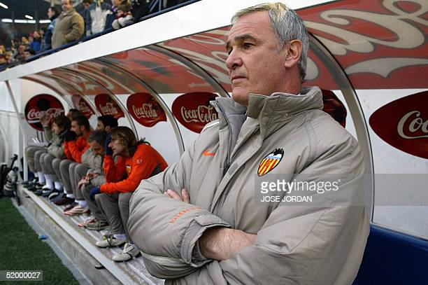 Valencia's coach Claudio Ranieri stands silent next to his players after receiving the news of the death of the daughter of Valencia's Portuguese...
