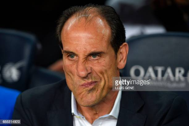 Valencia's coach Voro Gonzalez grimaces before the Spanish league football match FC Barcelona vs Valencia CF at the Camp Nou stadium in Barcelona on...