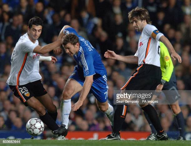 Valencia's David Albelda and Raul Albiol make it difficult for Chelsea striker Andriy Shevchenko to get past