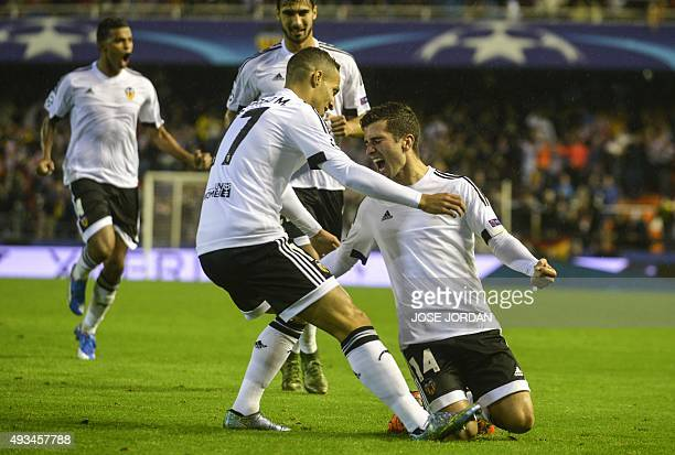 Valencia's defender Jose Gaya celebrates with teammates after scoring during the UEFA Champions League group H football match Valencia CF vs KAA Gent...