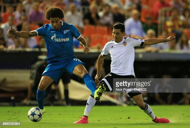 Valencia's Enzo Perez battles for the ball with Zenit St Petersburg's Axel Witsel