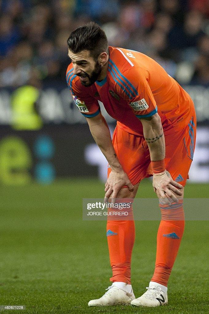 Valencia's forward Alvaro Negredo reacts during the Spanish league football match Malaga CF vs Valencia CF at La Rosaleda stadium in Malaga on February 2, 2015.