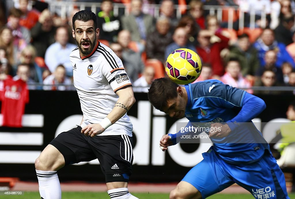 Valencia's forward <a gi-track='captionPersonalityLinkClicked' href=/galleries/search?phrase=Alvaro+Negredo&family=editorial&specificpeople=4085785 ng-click='$event.stopPropagation()'>Alvaro Negredo</a> (L) vies with Getafe's Uruguayan defender Emiliano Velazquez during the Spanish league football match Valencia CF vs Getafe CF at Mestalla stadium in Valencia on February 15, 2015.