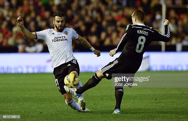 Valencia's forward Alvaro Negredo vies with Real Madrid's German midfielder Toni Kroos during the Spanish league football match Valencia CF v Real...