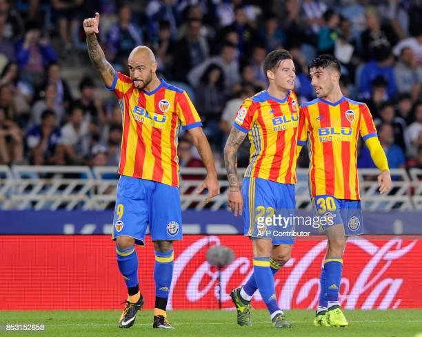 Valencia's forward from Italy Simone Zaza celebrates after scoring his team's third goal during the Spanish league football match Real Sociedad vs...
