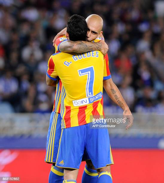 Valencia's forward from Italy Simone Zaza is congratulated by teammate forward from Portugal Goncalo Guedes after scoring his team's third goal...