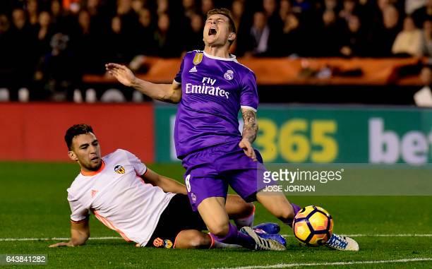Valencia's forward Munir El Haddadi vies with Real Madrid's German midfielder Toni Kroos during the Spanish league football match Valencia CF vs Real...