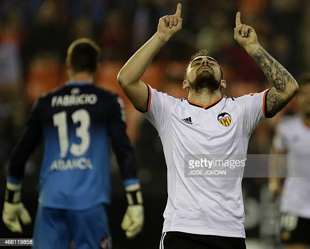 Valencia's forward Paco Alcacer celebrates his goal during the Spanish league football match Valencia CF vs RC Deportivo de la Coruna at the Mestalla...