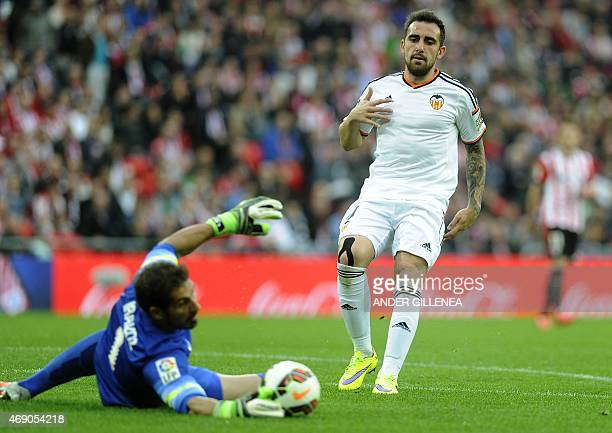 Valencia's forward Paco Alcacer vies with Athletic Bilbao's goalkeeper Gorka Iraizoz during the Spanish league football match Athletic Club vs...