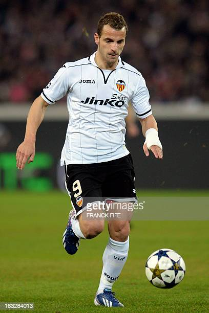 Valencia's forward Roberto Soldado runs with the ball during the UEFA Champions League round of 16 second leg football match between Paris...