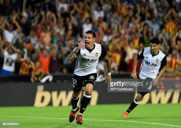 Valencia's forward Santi Mina celebrates after scoring a goal during the Spanish league football match Valencia CF vs Sevilla FC at the Mestalla...