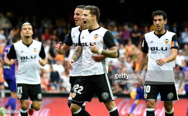 Valencia's forward Santi Mina celebrates after scoring a goal during the Spanish league footbal match Valencia CF vs Club Deportivo Leganes SAD at...