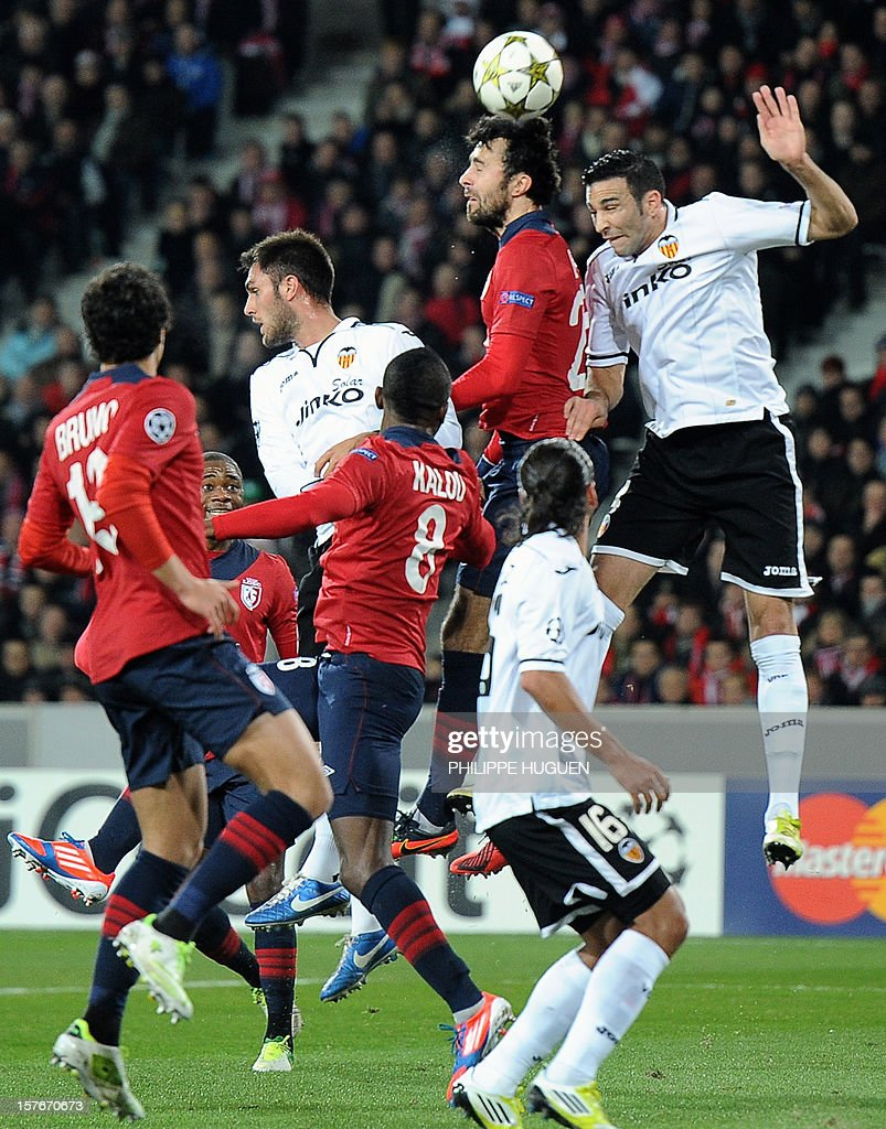 Valencia's French defender Adil Rami (R) fights for the ball with Lille's Montenegrin defender Marko Basa during the UEFA Champions League football match Lille vs Valencia CF on December 5, 2012 at the Grand Stade, in Villeneuve-d'Ascq.