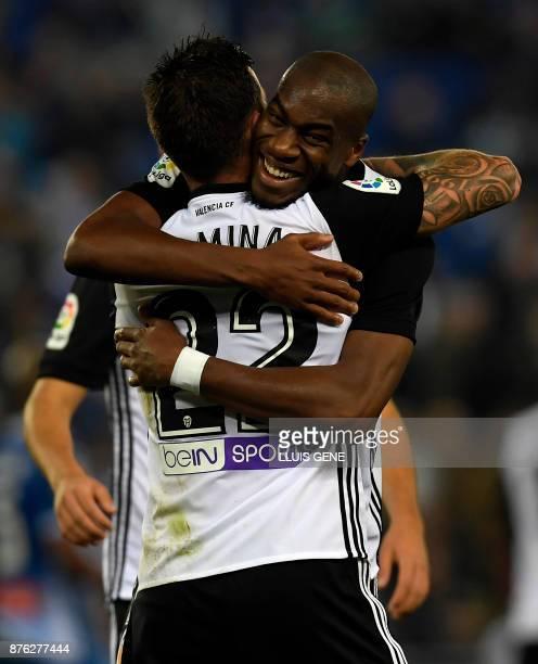 Valencia's French midfielder Geoffrey Kondogbia celebrates with Valencia's Spanish forward Santiago Mina Lorenzo during the Spanish league football...