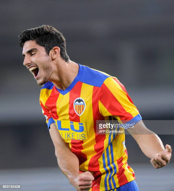 Valencia's froward from Portugal Goncalo Guedes celebrates after teammate forward from Italy Simone Zaza scored his team's third goal during the...