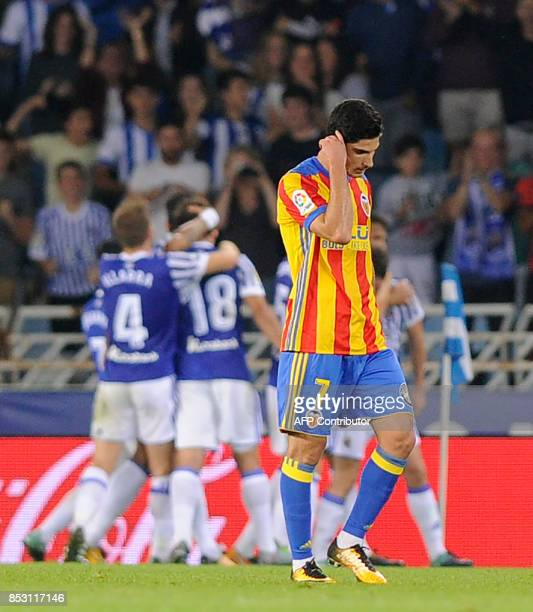 Valencia's froward from Portugal Goncalo Guedes walks on the pitch after Real Scoiedad scored during the Spanish league football match Real Sociedad...