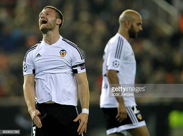Valencia's German defender Shkodran Mustafi shouts after missing an attempt on goal during the UEFA Champions League football match Valencia CF vs...