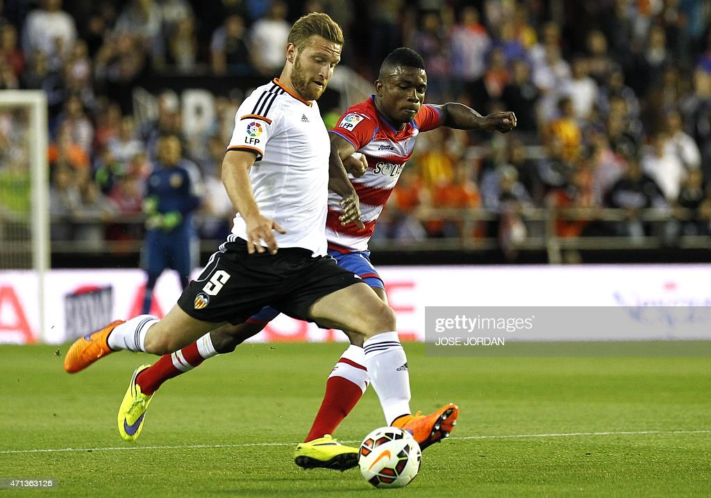 Valencia's German defender <a gi-track='captionPersonalityLinkClicked' href=/galleries/search?phrase=Shkodran+Mustafi&family=editorial&specificpeople=5006425 ng-click='$event.stopPropagation()'>Shkodran Mustafi</a> (L) vies with Granada's Colombian forward Jhon Cordoba during the Spanish league football match Valencia CF vs Granada FC at the Mestalla stadium in Valencia on April 27, 2015.