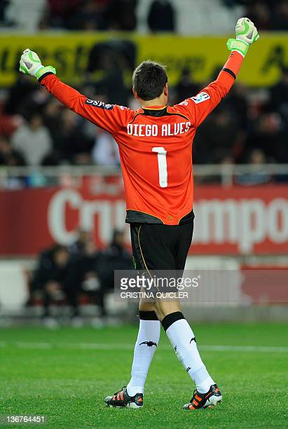 Valencia's goalkeeper Diego Alves celebrates after temmate Valencia's forward Roberto Soldado scored during the Spanish Cup football match Sevilla vs...