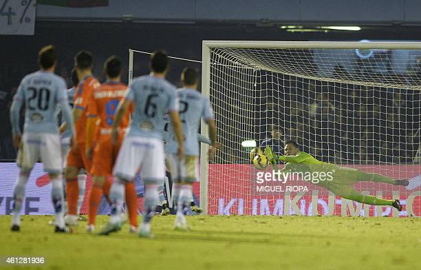 Valencia's goalkeeper Diego Alves stops a penalty executed by Celta's Chilean forward Fabian Orellana during the Spanish league football match RC...
